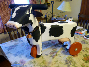 A photo in Hoard's Dairyman was used as the model for Phil Schroeder's cow kiddie cart. He said he has tried to make the carts look as much like a cow as possible. Photo by Jim Massey