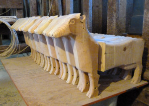 Schroeder is developing a whole herd of cow kiddie carts in his workshop near Loganville. Photo by Jim Massey
