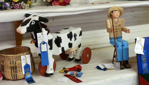 The Kiddie Cow Cart and Wooden Man are proudly on display at the Fair!